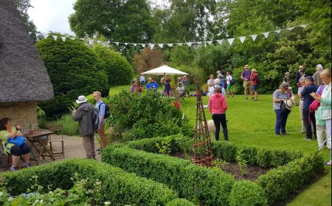 A view of the garden with people visiting, at Elgar's cottage Brinkwells