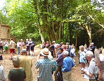 A panorama of local people, are seen enjoying a small choir at a derelict but beautiful chapel old chapel.