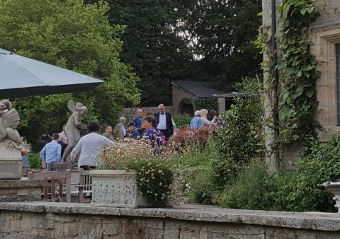 Image of people gathering in a lovely garden