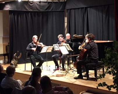 Image of a string quartet playing on a stage in Petworth