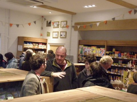 People meet and greet each other in the shop, including the vicar