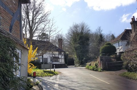 Image of old White Horse Cottages at a sharp bend in the road called hallelujah Corner